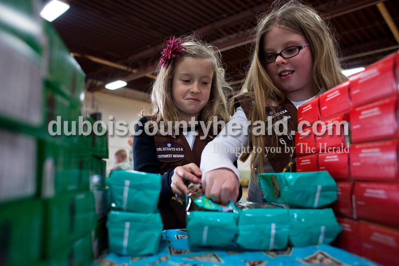Alisha Jucevic/The Herald <br /> Kristin Roos of Jasper, 8, and Taryn Truesdale of Ireland, 8, organized cookies on Saturday afternoon at the National Guard Armory in Jasper. Each member of the battalion got to choose two different boxes of cookies.