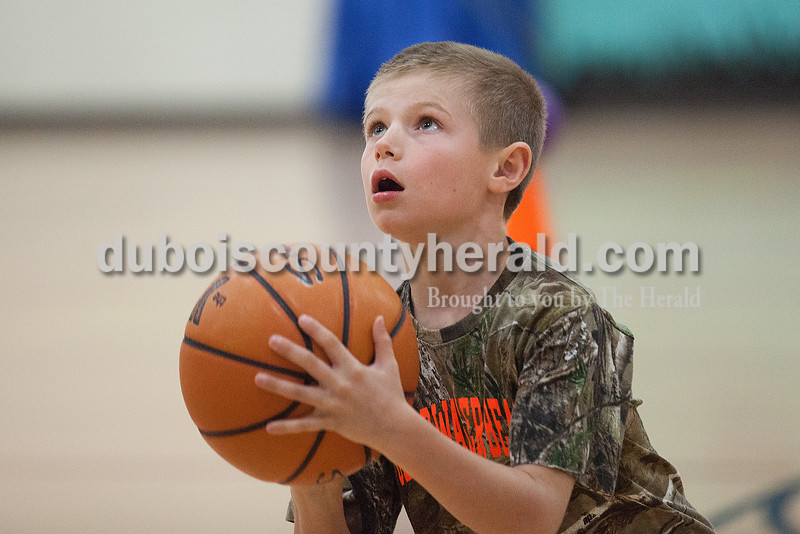 Blake Taylor of St. Henry, 9, aimed for a shot during a relay race at the YMCA in Ferdinand on Tuesday. With school out of session for spring break, the center is offering day camp for area children. Rachel Mummey/The Herald