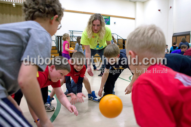 Pine Ridge Elementary second-graders Cayden Leisman, left, Cade Bayer, and Jack Kreilein passed a ball around their circle  during a celebration of Wellness Week on Friday afternoon at Pine Ridge Elementary. Second grade teacher and organizer of Wellness Week, Natalie Wells, helped them start the game. Alisha Jucevic/The Herald