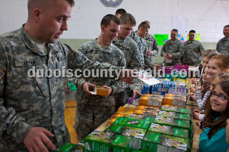 "Alisha Jucevic/The Herald <br /> Sergeant Derwin Lester of Indianapolis thanked the Girl Scouts for his hand drawn card on Saturday afternoon at the National Guard Armory in Jasper. Ireland's Girl Scout Troop 66 collected over 400 boxes of Girl Scout cookies and made thank you cards as a special project in order to earn their ""Give Back Badge"".  Each member of the battalion got to pick out two boxes of Girl Scout cookies."
