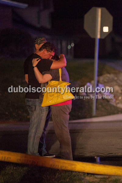 "Alisha Jucevic/The Herald  <br /> <br /> James ""Jim"" Gatwood hugged Melissa Gatwood outside James' residence on Wednesday night as firefighters worked to put out a fire in his home at 102 East 22nd Street in Huntingburg. The fire was reported around 8:40 p.m. and took about an hour to put out. Assistant fire chief Glen Kissling said the fire originated in the laundry room and left major damage throughout the house. Co-homeowner and the resident of the home James Gatwood was not home when the fire began and no one was injured at the scene."
