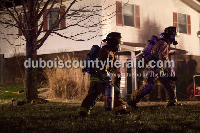 Alisha Jucevic/The Herald  <br /> <br /> Firefighters worked to put out a house fire on Wednesday night at 102 East 22nd Street in Huntingburg. The fire was reported around 8:40 p.m. and took about an hour to put out. Assistant fire chief Glen Kissling said the fire originated in the laundry room and caused major damage throughout the house. Co-homeowner and the resident of the home, James Gatwood, was not home when the fire began and no one was injured at the scene.