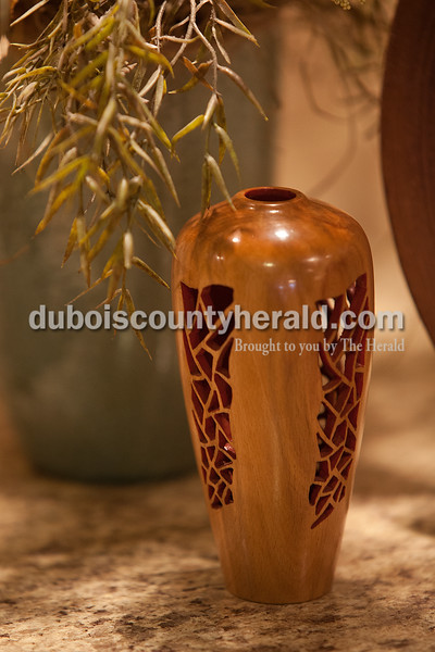 A small intricately cut vase created by Hubbs sits on the counter in his Ferdinand home.