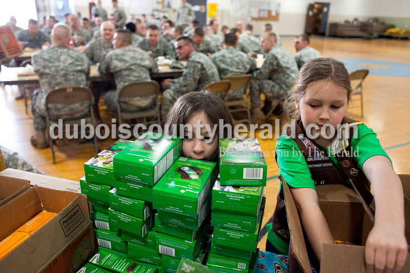 Mickinzie Marks of Jasper, 7, left, and  Addison Owens of Ireland, 7, organized Girl Scout cookies on Saturday afternoon at the National Guard Armory in Jasper. Alisha Jucevic/The Herald