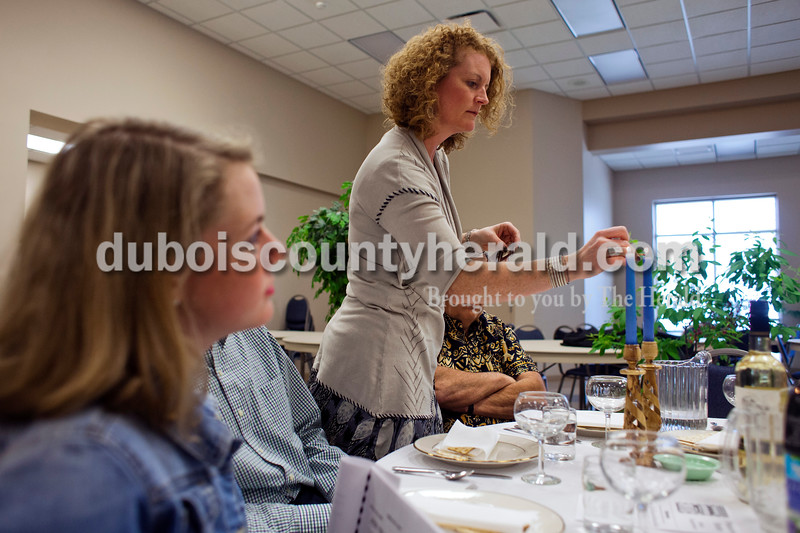 Alisha Jucevic/The Herald <br /> <br /> Olivia Smith watched as her mother Jodi Smith, both of Jasper, lit two candles at the beginning of the Seder meal on Sunday at Holy Family Church in Jasper. The Seder meal is an ancient celebration of the Jews' release from Egyptian bondage. By eating a meal together and sharing conversation, participants remember God's continuing gift of freedom and life.
