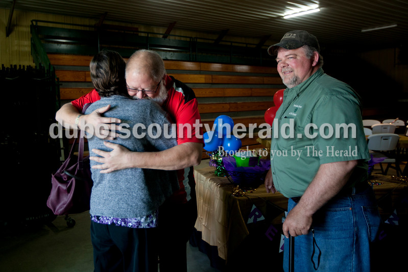 Ariana van den Akker/The Herald<br /> Kendall Martin, Dubois County Purdue Extension director and 4-H youth development educator, got a hug from Charlotte Hunter of Holland during his retirement open house at the Clover Pavilion at the Dubois County 4-H Fairgrounds in Bretzville. Both Martin and Diane Smith, a family nutrition program assistant, are retiring from Purdue Extension-Dubois County. Bret Collignon of Jasper, president of the Dubois County 4-H Council, looked on.