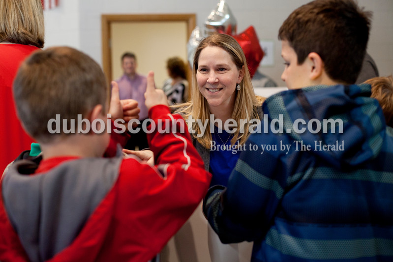 Ariana van den Akker/The Herald<br /> Precious Blood third grade teacher Kathy Wolf got a thumbs up from third-grader Brandon Mehringer as his classmate Will Wallace helped hold up the ceremonial check after learning she received a Peabody Energy Leaders in Education award during a surprise assembly on Tuesday at the school.
