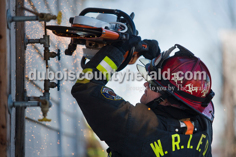Alisha Jucevic/The Herald <br /> <br /> Dusty Ramer, lieutenant with the White River Township Fire Department used a K-12 fire rescue saw during a truck company operations course on Saturday at a training facility in Huntingburg.