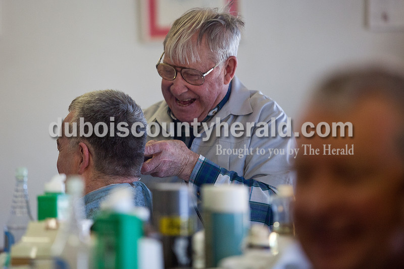 """Leo Wahl of Ferdinand trimmed the hair of Father Michael Madden of the St. Anthony of Padua and Sacred Heart of Jesus Catholic Church in Schnellville at Wahl's barbershop in Jasper on Monday. """"He makes it in here about every thirty days,"""" Wahl said of Father Madden getting his hair cut. Rachel Mummey/The Herald"""