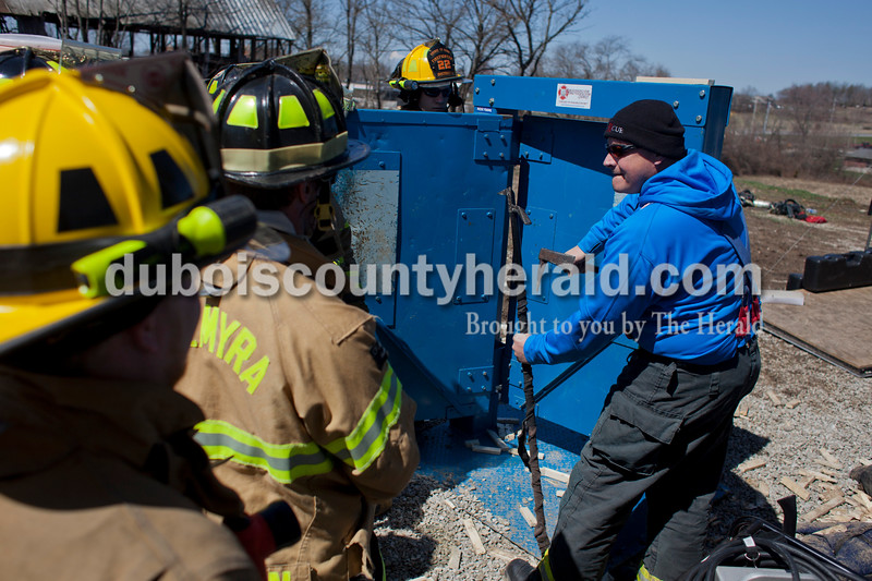 Alisha Jucevic/The Herald <br /> <br /> Kyle Brooks, lieutenant at White River Township Fire Department, right, instructed a group on forceable entry during a truck company operations course on Saturday at a training facility in Huntingburg.