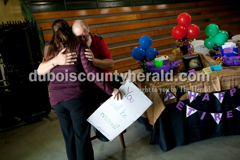 Ariana van den Akker/The Herald<br /> Kendall Martin, Dubois County Purdue Extension director and 4-H youth development educator, got a hug from Annette Applegate of Schnellville and a card from the Schnellville Busy Bees 4-H club during his retirement open house at the Clover Pavilion at the Dubois County 4-H Fairgrounds in Bretzville. Both Martin and Diane Smith, a family nutrition program assistant, are retiring from Purdue Extension-Dubois County.