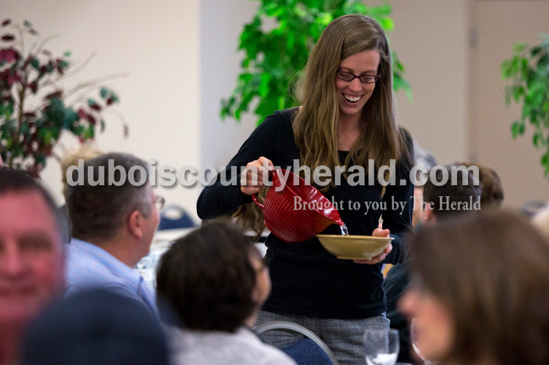 Alisha Jucevic/The Herald <br /> <br /> Carley Knapp of Jasper poured water into bowls for the attendants to use to wash their hands during the Seder meal on Sunday at Holy Family Church in Jasper. Knapp, the Saint John Bosco Director, helped out at the event with a few other members of Bosco.