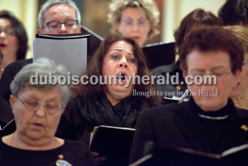 Gabi Mueller of the Sankt Caecilia Choir of St. Ganglof Church from Duddenhofen, Germany sang during a performance at St. Ferdinand Catholic Church in Ferdinand on Saturday evening. The group received a tour at Mary Help of Christians Church in Mariah Hill in hopes of connecting ancestral ties to the area. Rachel Mummey/The Herald