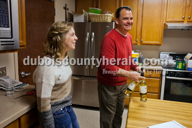 Alisha Jucevic/The Herald <br /> <br /> Catherine Bell, 18, and her father Tim, both of Jasper, worked in the kitchen before the Seder meal on Sunday at Holy Family Church in Jasper. Tim Bell and his wife Dee were two of the main organizers for the meal.