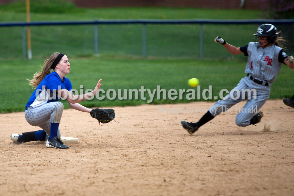 Northeast Dubois' Clare Mangin kneeled to catch the ball as Barr Reeve's Courtney Pruett slid safe into second base during Tuesday night's game against Barr-Reeve in Dubois. The Jeeps lost 8-2. <br /> <br /> Alisha Jucevic/The Herald
