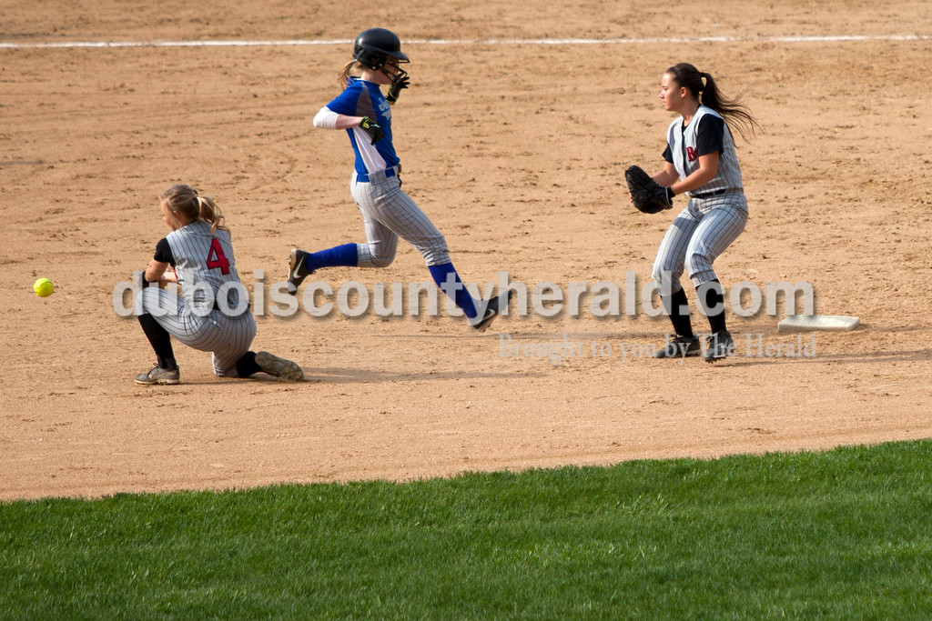 Northeast Dubois'  Chloe Johnson ran safely into second base as Barr Reeve's Hannah Bullock knelt to catch the ball and Kendra Yoder defended during Tuesday night's game against Barr-Reeve in Dubois. The Jeeps lost 8-2. <br /> <br /> Alisha Jucevic/The Herald