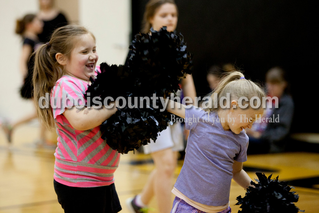 Ariana van den Akker/The Herald<br /> Rhealynn Shaw, 6, and Tori Gunselman, 5, both of Jasper, played around with their pom poms during High Ponies, a free cheer and dance clinic for kindergarteners to fifth-graders that includes life lessons, on Tuesday evening at Jasper Middle School.