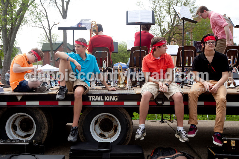 Ariana van den Akker/The Herald<br /> Angela Poole, 15, left, Kyle Mehringer, 16, Garrett Armstrong, 16, and Isaac Messersmith, 15, all of Jasper, took a break as they were getting ready to perform with the rest of the Jasper Jazz Band at the Garden Gate Jazz, Art, Wine and Craft Beer Festival in Huntingburg on Saturday.