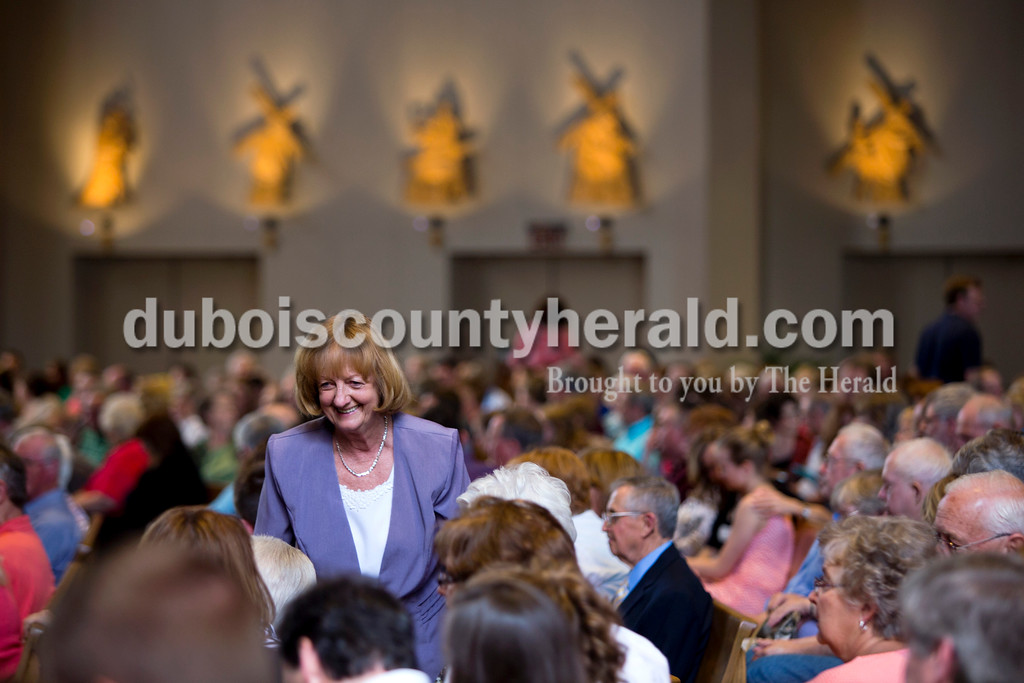 Alene Berg of Kyana greeted friends during mass on Saturday afternoon at Holy Family in Jasper.<br /> <br /> Alisha Jucevic/The Herald