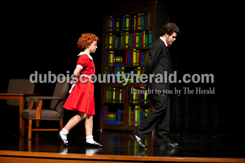 Ariana van den Akker/The Herald<br /> Jasper Middle School sixth-grader Maci Buck, as Annie, imitated the walk of eight-grader Lucas Stenftenagel, as Daddy Warbucks, during dress rehearsal for Annie Jr. at the school on Monday. The students will perform the show Thursday, Friday and Saturday at 6:30 p.m. and Sunday at 2 p.m. Tickets are $5 at the door.