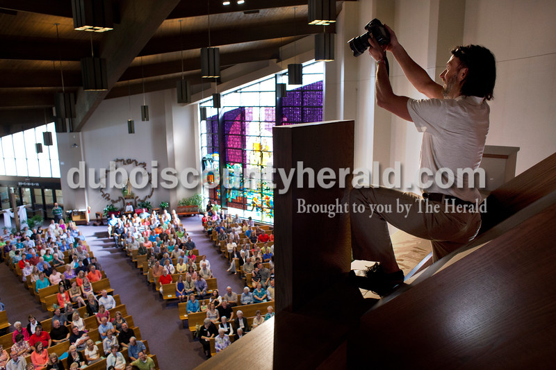 Jay Hamlin of Jasper photographed the filled hall at Holy Family during mass on Saturday afternoon at Jasper. Since Holy Family is merging with Precious Blood, they decided to honor all the families that have made up Holy Family over the years. Over 800 adults and over 100 children registered for the event.  <br /> <br /> Alisha Jucevic/The Herald