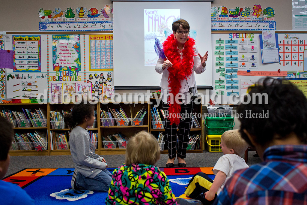 "Huntingburg Elementary first grade teacher Sara Prusz read a ""Fancy Nancy"" storybook to a group of children during the Dubois County Family Literacy Night on Monday evening at Huntingburg Elementary. The event sessions provided practical ways for families to extend literacy experiences into their everyday lives. <br /> Alisha Jucevic/The Herald"