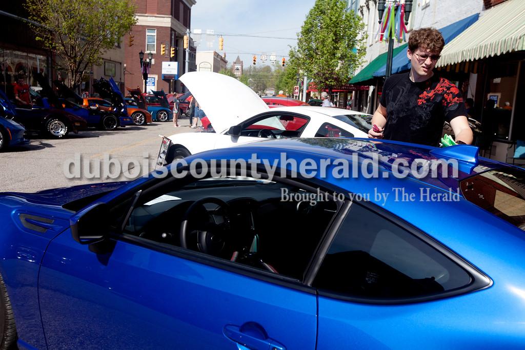 Ariana van den Akker/The Herald<br /> Shane Wood of Jasper buffed his 2015 Subaru BRZ during the Annual Huntingburg Kiwanis Car Show on Fourth Street in Huntingburg on Saturday.