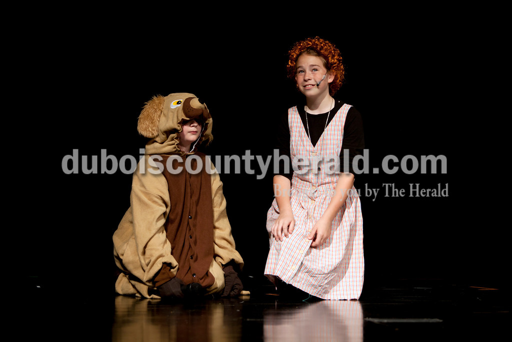 "Ariana van den Akker/The Herald<br /> Jasper Middle School sixth-graders Josh Schoenbachler, left, as Sandy, and Maci Buck as Annie, practiced the song ""Tomorrow"" during dress rehearsal for Annie Jr. at the school on Monday. The students will perform the show Thursday, Friday and Saturday at 6:30 p.m. and Sunday at 2 p.m. Tickets are $5 at the door."