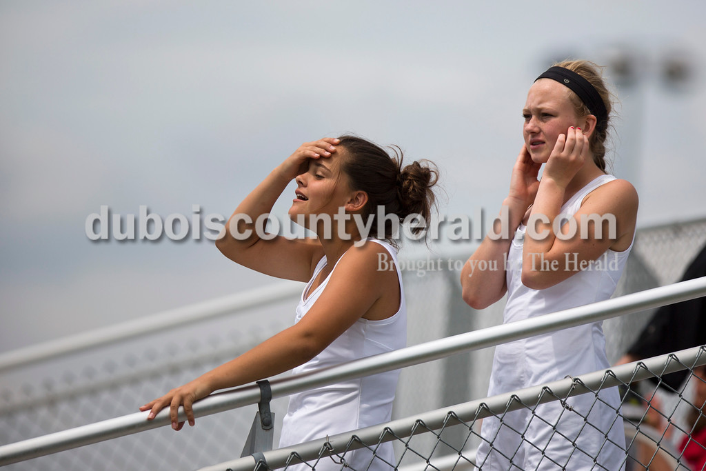 Jasper High School freshman Maggie Getzin and Averie Himsel watch their teammates play during the match against McCracken County in the Jasper Four-Team Invitational on Saturday. Jasper lost to McCracken County 3-2. <br /> <br /> Alisha Jucevic/The Herald