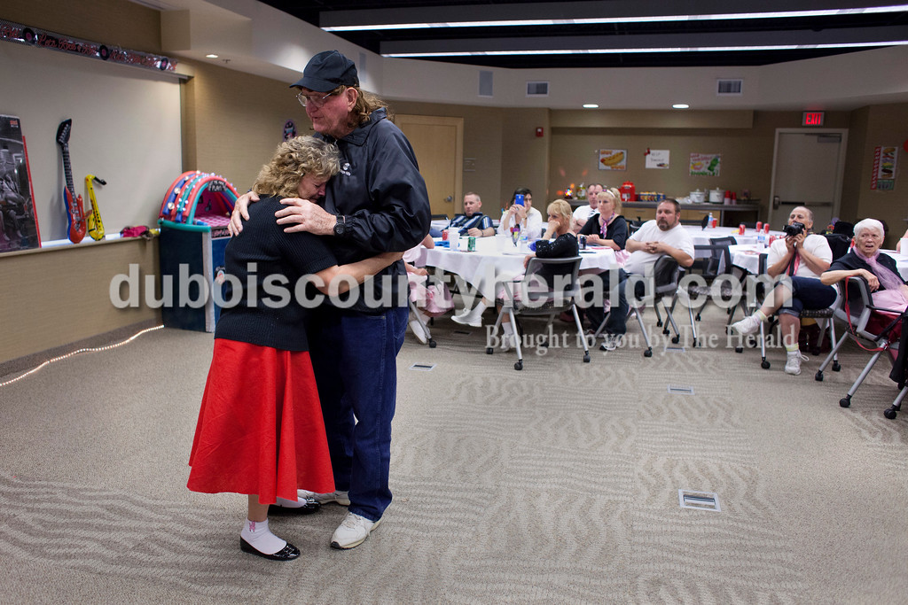 "Karyn and her husband Paul Gary ""Red"" Bender danced together during their Rock and Roll themed 50th anniversary party on Saturday in Huntingburg. At the end of last year Red was diagnosed with Stage 4 pancreatic cancer. ""I can remember the first time I kissed him,"" said Karyn. <br /> <br /> Alisha Jucevic/The Herald"