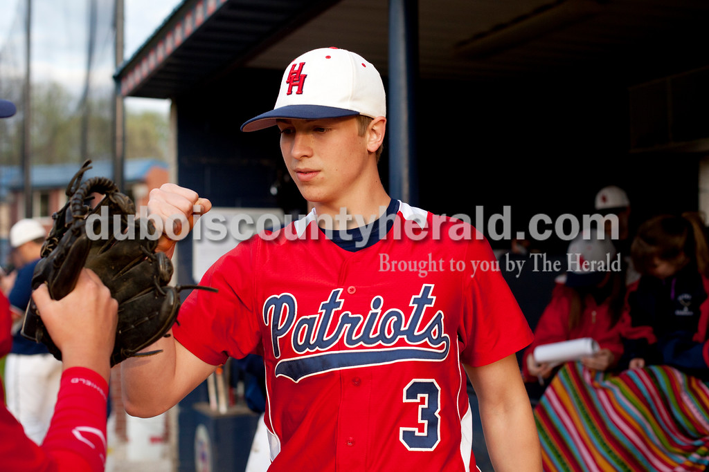 Heritage Hills' Tucker Gogel greeted his teammates as they came off the field during Monday evening's game against Jasper in Lincoln City. The Wildcats won 12-0 in six innings. Ariana van den Akker/The Herald