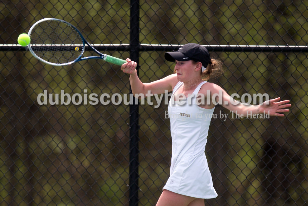 Jasper's Sarah Monesmith forehanded the ball during the match against McCracken County in the Jasper Four-Team Invitational on Saturday. Jasper lost to McCracken County 3-2. <br /> <br /> Alisha Jucevic/The Herald