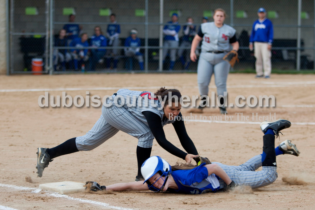 Barr Reeve's Kacey Jones tagged out Clare Mangin as Mangin tried to make it back to second base during Tuesday night's game against Barr-Reeve in Dubois. The Jeeps lost 8-2. <br /> <br /> Alisha Jucevic/The Herald