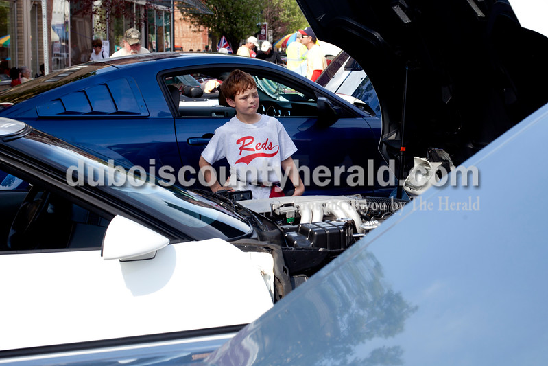 Ariana van den Akker/The Herald<br /> Joshua Carrico of Duff, 6, checked out a 1990 Corvette at the Annual Huntingburg Kiwanis Car Show on Fourth Street in Huntingburg on Saturday.