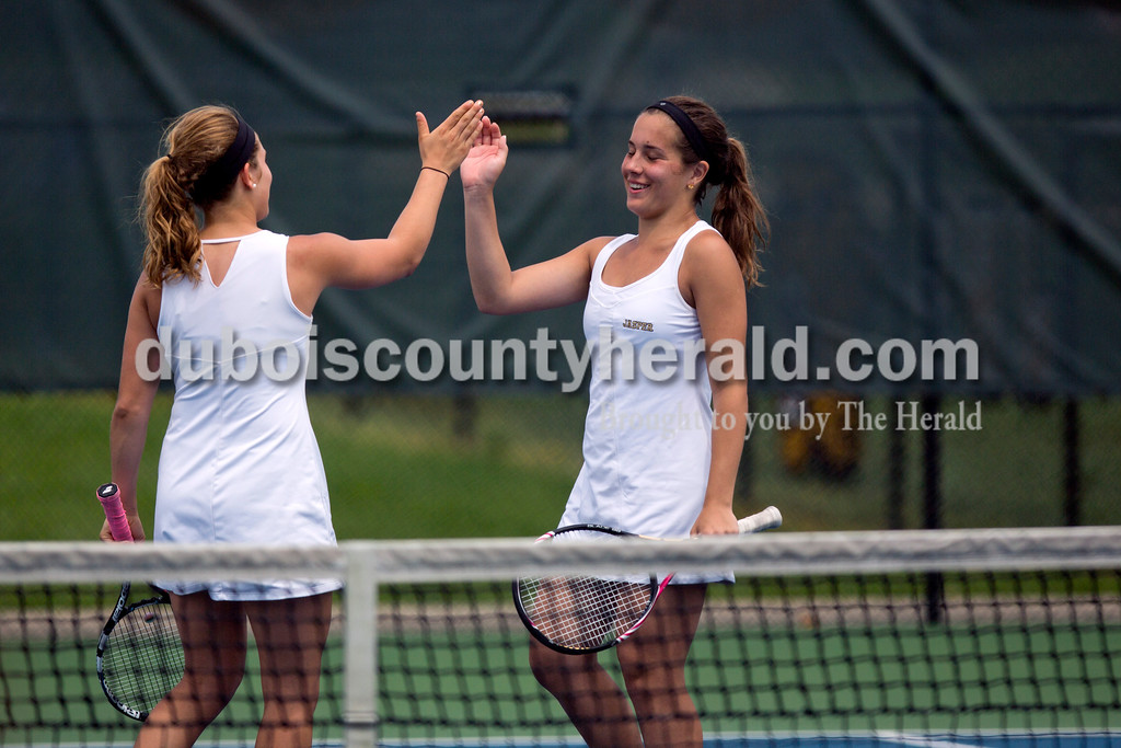 Jasper's Anna Flick and Emma Seger high-fived during their doubles match against McCracken County in the Jasper Four-Team Invitational on Saturday. Jasper lost to McCracken County 3-2. <br /> <br /> Alisha Jucevic/The Herald