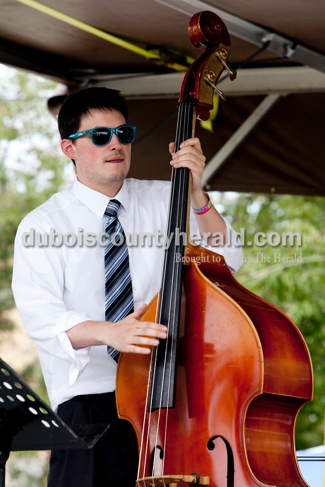 Ariana van den Akker/The Herald<br /> Dave Neill of Louisville played bass while the band he is in, Small Time Napoleon, played at the Garden Gate Jazz, Art, Wine and Craft Beer Festival in Huntingburg on Saturday.