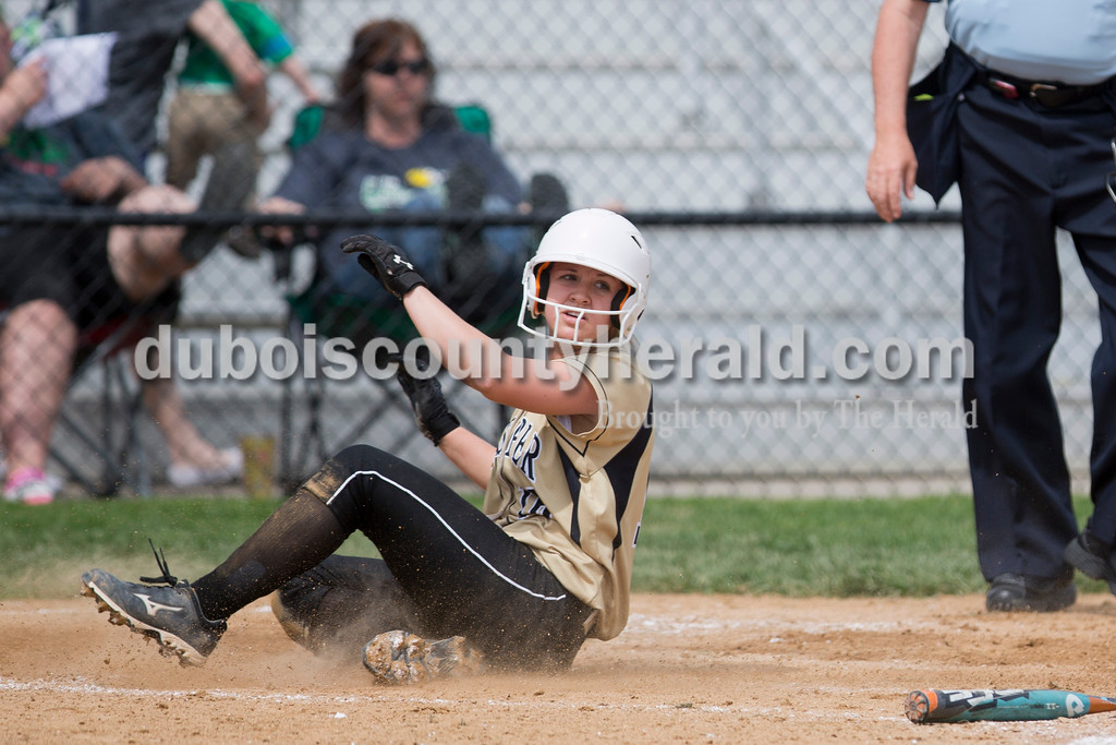 Jasper's Nicolette Eckert slid into home plate during the game against Perry Central on Saturday in the Jasper Invitational. Jasper won 12-0. <br /> <br /> Alisha Jucevic/The Herald