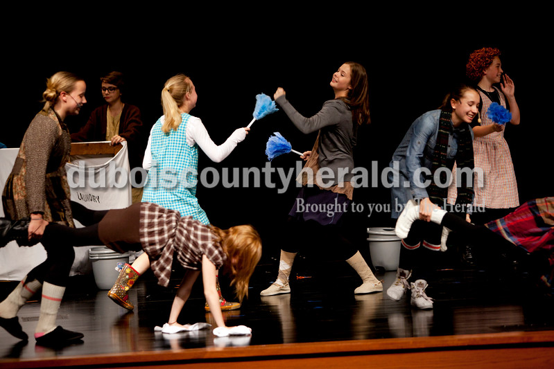 "Ariana van den Akker/The Herald<br /> Jasper Middle School students perform ""It's the Hard Knock Life"" during dress rehearsal for Annie Jr. at the school on Monday. The students will perform the show Thursday, Friday and Saturday at 6:30 p.m. and Sunday at 2 p.m. Tickets are $5 at the door."