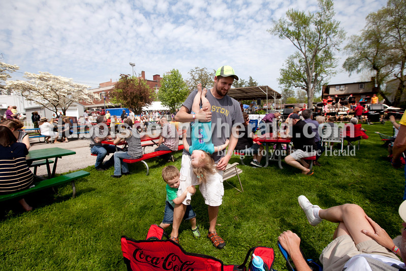 Ariana van den Akker/The Herald<br /> Luke Duval of Indianapolis played with his children Eli, 3, and Issy, 1, while listening to music at the Garden Gate Jazz, Art, Wine and Craft Beer Festival in Huntingburg on Saturday. The Duvals were in town to visit Luke's father Thom Duval of Huntingburg.