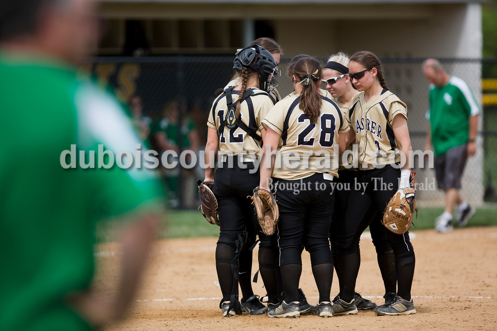 The Jasper team huddled together during the game against Perry Central on Saturday in the Jasper Invitational. Jasper won 12-0. <br /> <br /> Alisha Jucevic/The Herald