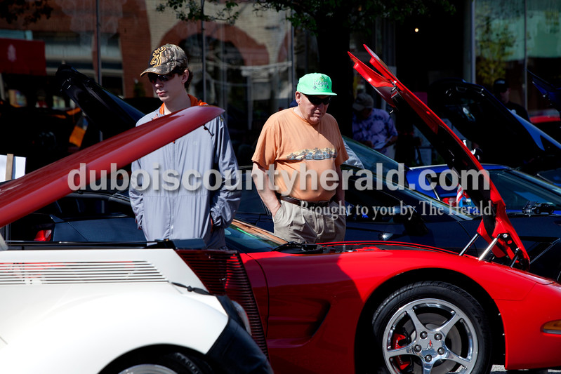 Ariana van den Akker/The Herald<br /> Collin Daniel of Madisonville, Ky., 15, and Jim Moore of Bruceville checked out Corvettes at the Annual Huntingburg Kiwanis Car Show on Fourth Street in Huntingburg on Saturday.