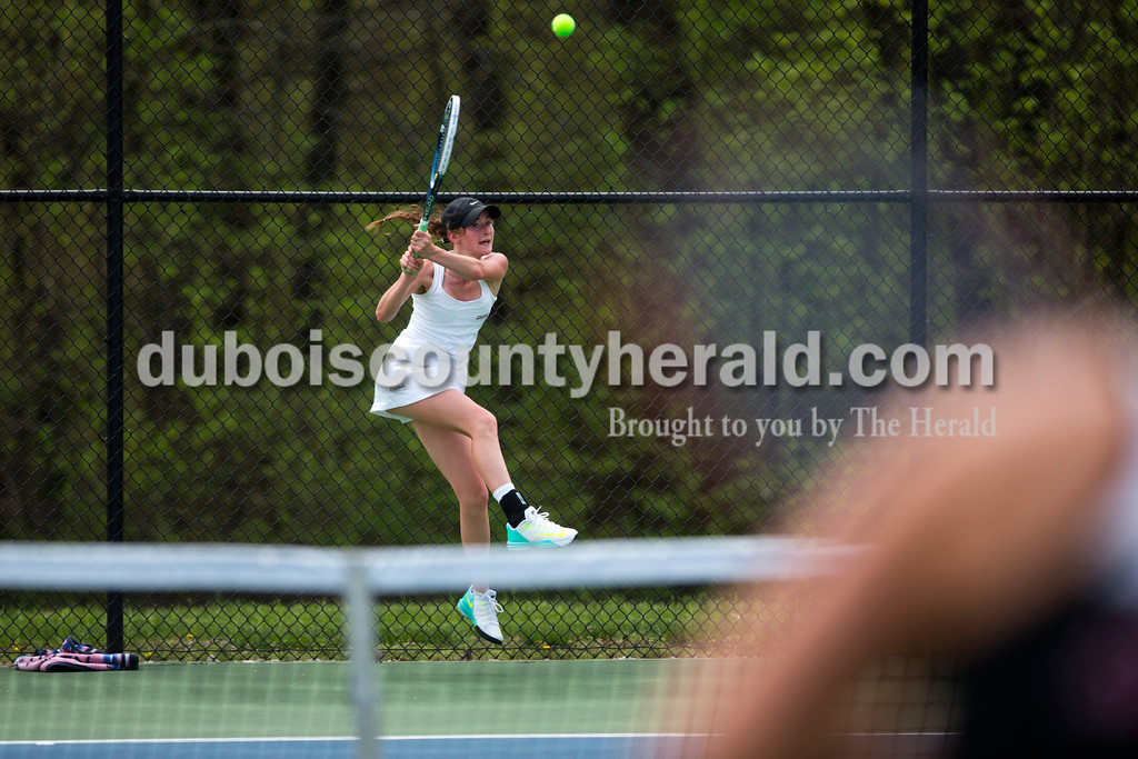 Jasper's Sarah Monesmith jumped in the air to return the ball during the match against McCracken County in the Jasper Four-Team Invitational on Saturday. Jasper lost to McCracken County 3-2. <br /> <br /> Alisha Jucevic/The Herald