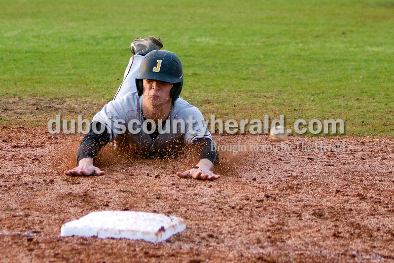 Jasper's Grant Theil dove to third base as the ball flow past him during Monday evening's game against Heritage Hills in Lincoln City. The Wildcats won 12-0 in six innings. Ariana van den Akker/The Herald
