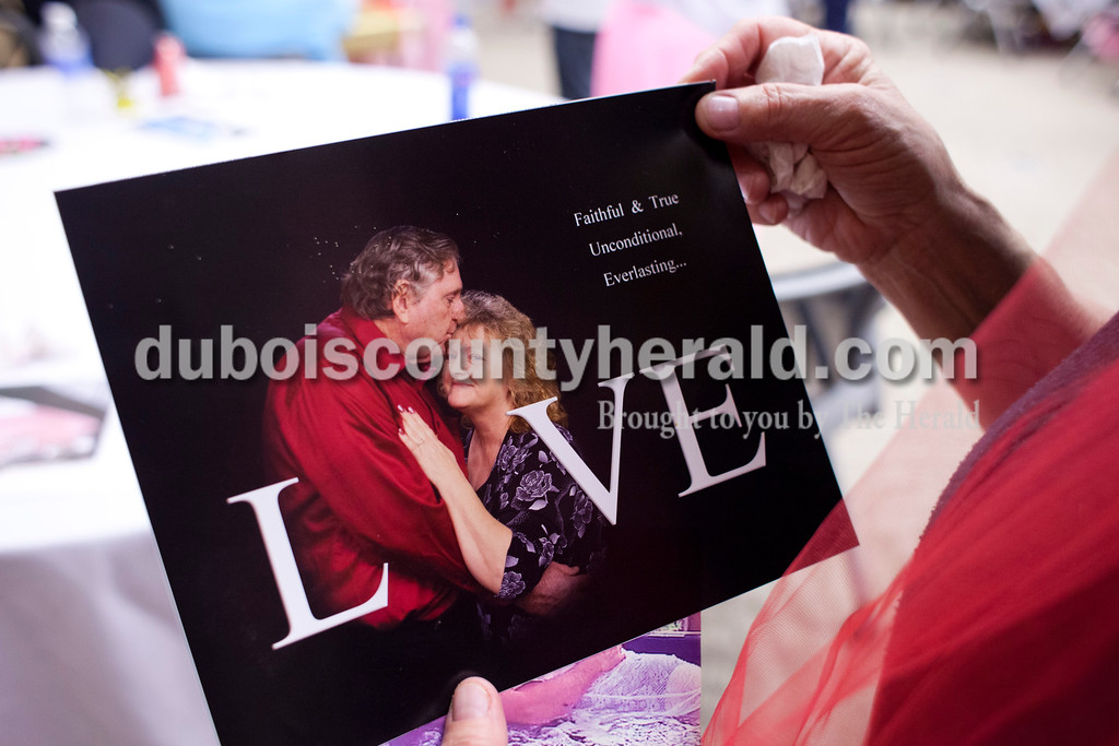 "Karyn Bender held a photograph of her and her husband that was taken before he was diagnosed with stage 4 pancreatic cancer last year. ""He and I are best friends,"" she said. ""You know, when you can say anything to each other."" <br /> <br /> Alisha Jucevic/The Herald"