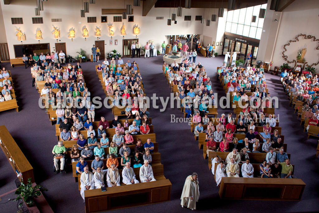 Father John Boeglin stood in front of a filled room at Holy Family during mass on Saturday in Jasper. Since Holy Family is merging with Precious Blood, they decided to honor all the families that have made up Holy Family over the years. Over 800 adults and over 100 children were registered for the event.  <br /> <br /> Alisha Jucevic/The Herald