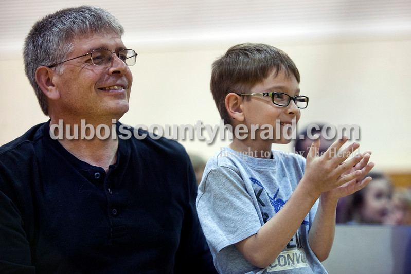 Eli Englert, 6, and his father Marty, both of Huntingburg watched the NAO humanoid robot presentation at the beginning of the Dubois County Family Literacy Night on Monday evening at Huntingburg Elementary. The event sessions provided practical ways for families to extend literacy experiences into their everyday lives. <br /> <br /> Alisha Jucevic/The Herald