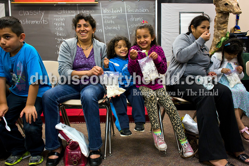 Maria Calderol ate ice cream with her children Miguel, 3, and Adamaris, 8, all of Huntingburg, during a mini session at the Dubois County Family Literacy Night on Monday evening at Huntingburg Elementary. Eric Rico of Huntingburg, 7, sat on their left and Fatima Barahona and her daughter Victoria Vanegas, 7, both of Holland, sat on their right. <br /> <br /> Alisha Jucevic/The Herald