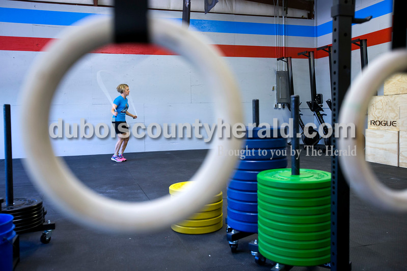 "Andrea Hopf of Jasper jumped roped to warm up before a CrossFit class at CrossFit Discipline on Tuesday evening in Jasper. After opening only two weeks ago, the gym has over 30 members. ""Everyone makes each other accountable,"" said gym owner Amy Woebkenberg. ""It's a community."" <br /> Alisha Jucevic/The Herald"