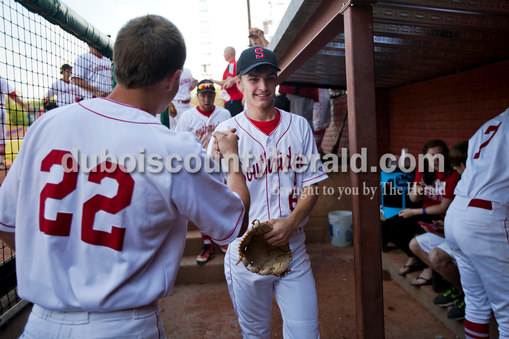 Southridge's Matthew Tretter fist bumped Luke Stetter as the team ran into the dugout during Wednesday night's game against Tecumseh at League Stadium in Huntingburg. The Raiders won 6-1. <br /> Alisha Jucevic/The Herald