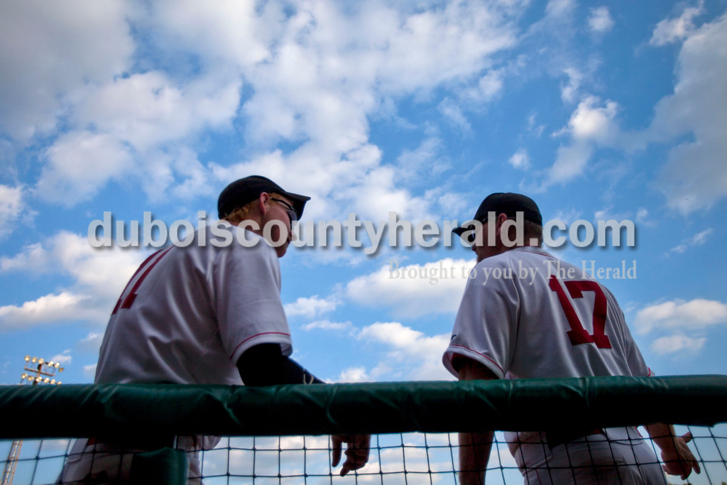Southridge's Dillion Ramsey talked with head coach Dave Schank in between innings during Wednesday night's game against Tecumseh at League Stadium in Huntingburg. The Raiders won 6-1. <br /> Alisha Jucevic/The Herald